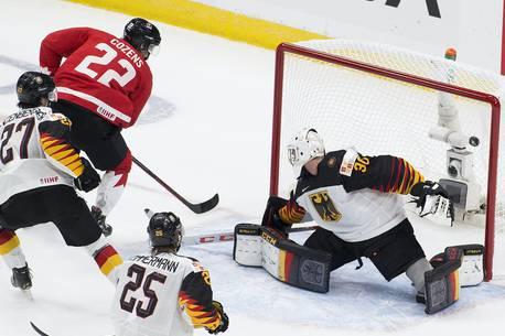 Canada's Dylan Cozens (22) scores on Germany's goalie  Jonas Gahr (30) during second period IIHF World Junior Hockey Championship action on Saturday, Dec. 26, 2020 in Edmonton.