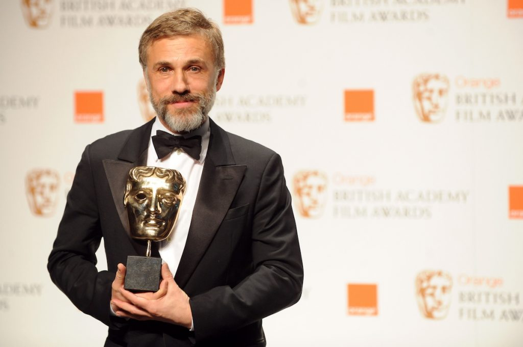 Austrian actor Christoph Waltz poses for photographers with his British Academy of Film Award (BAFTA) for