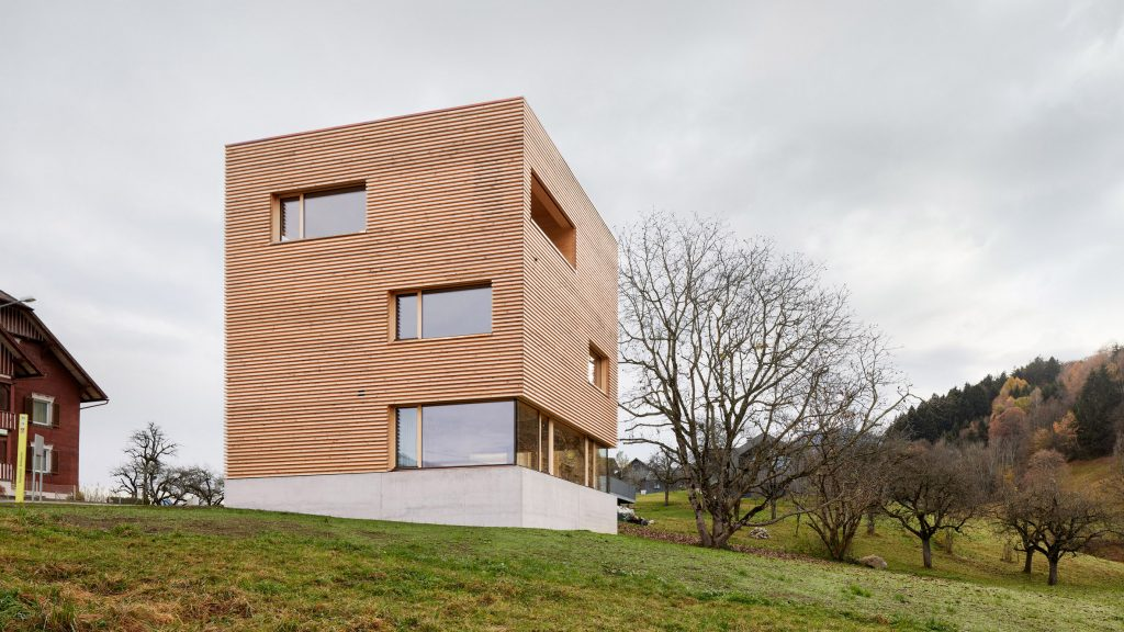 A square wood-clad house in an Austrian village