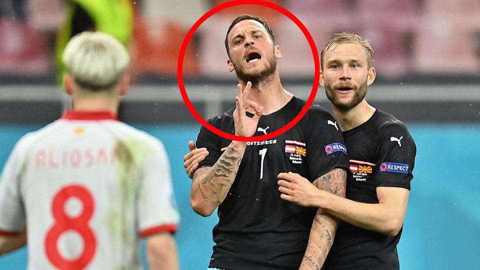 Marko Arnautovic ist hier zu sehen, wie er einen nordmezedonischen Spieler bei der Euro 2020 beleidigt.